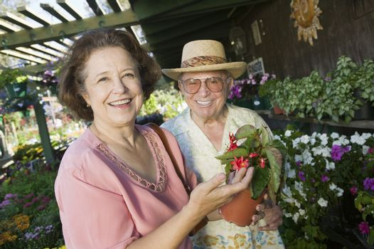Senior Couple Shopping for flowers at plant nursery portrait