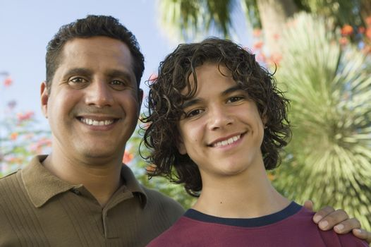 Father with Arm Around Son (13-15) front view portrait.