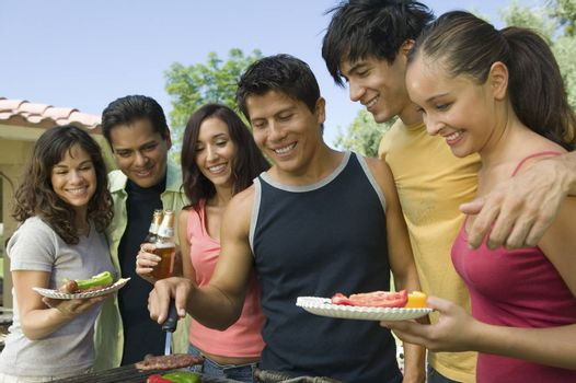 Group Of Casual Friends Enjoying A Barbecue