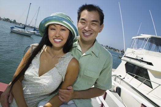 Couple smiling at marina (portrait)