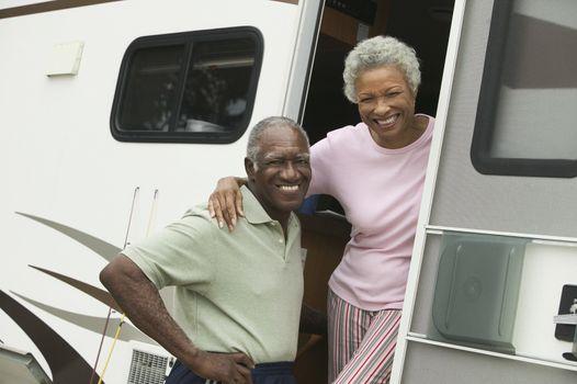 Senior couple with motor home (portrait)