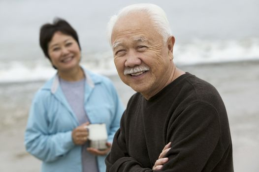 Mature man and wife at beach (portrait)