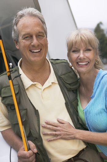 Fisherman with wife outdoors (portrait)