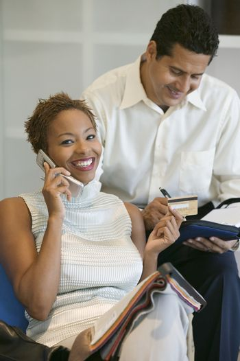 Couple Making a Purchase With Credit Card over mobile phone