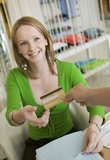 Young woman Paying for Clothes with Credit Card
