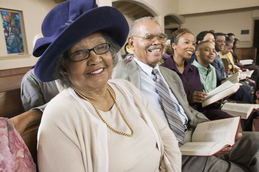 Senior Woman in Sunday Best among congregation at Church portrait