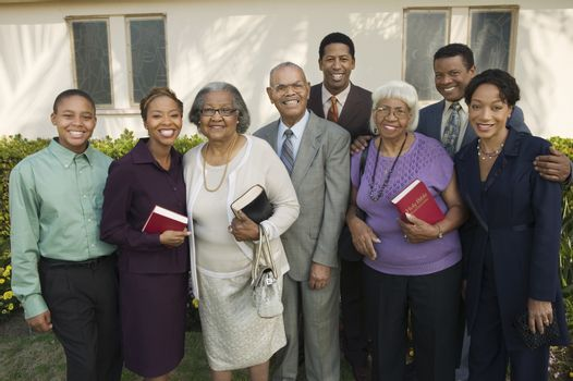 Christian Family on patio holding Bibles portrait