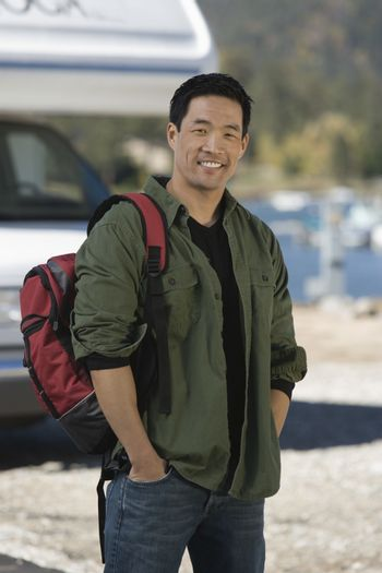 Man wearing backpack by RV