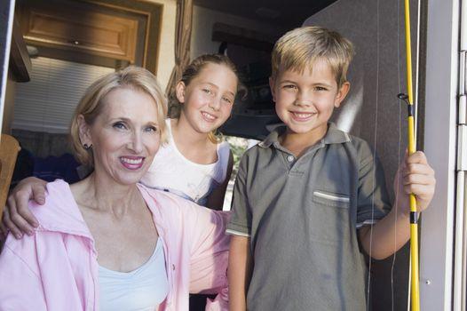 Portrait of mother and children in camper van