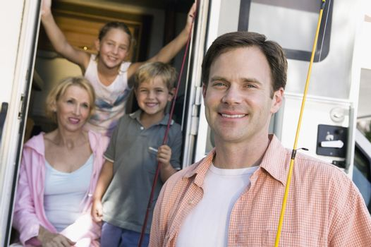 Portrait of family with camper van