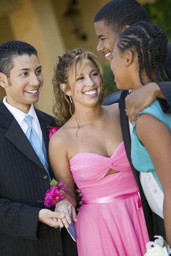 Well-dressed teenage couples talking outside