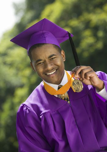 Graduate Holding Medal outside portrait