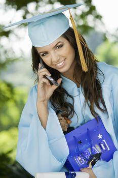 Female Graduate Using Cell Phone