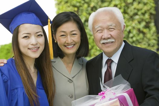 Graduate with mother and grandfather outside portrait