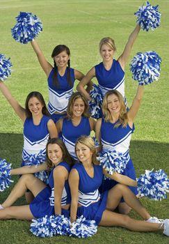 Cheerleaders posing on lawn (portrait)
