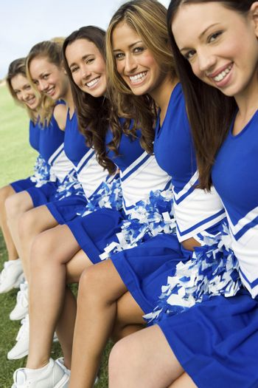 Cheerleaders sitting on bench (portrait)