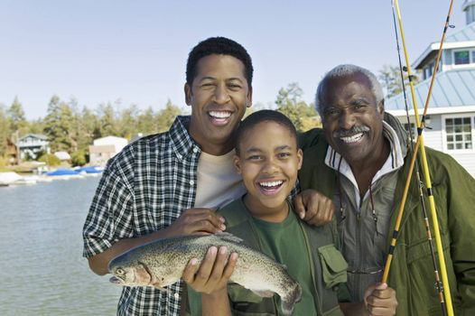 Happy Family With Fishing Rod And Fish