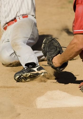 Player sliding towards the base to complete a run