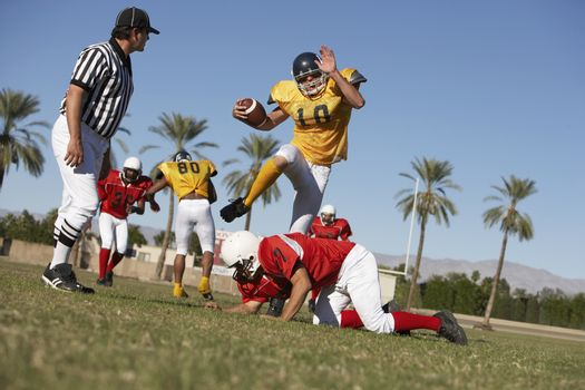 Football players in action on field ground view