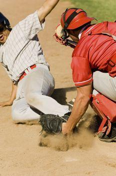 Closeup of two baseball players at home base