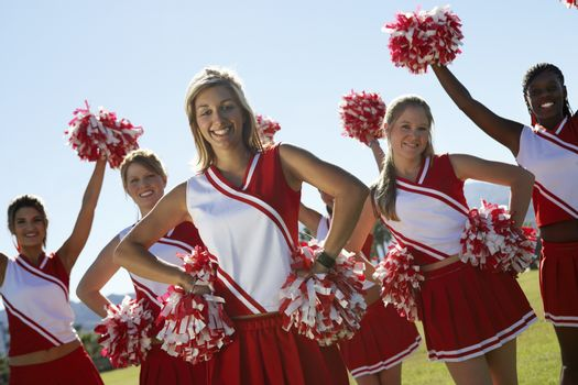 Cheerleading squad standing in formation on field portrait (portrait)