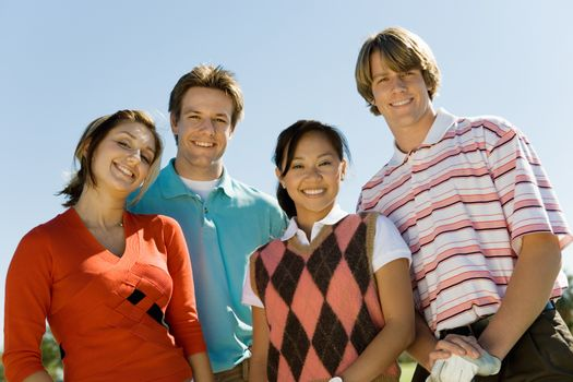 Group portrait of happy young multiethnic friends smiling