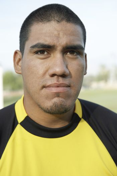 Close-up portrait of a Hispanic soccer goalkeeper