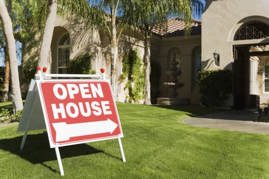 Open house sign in front of a house