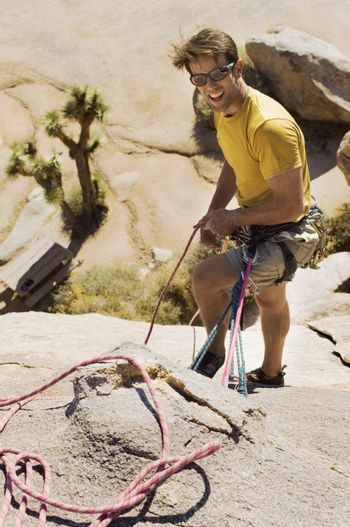 Climber with Ropes on Cliff
