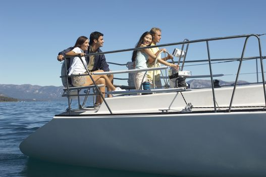 Group of multi ethnic friends travelling on a sailboat