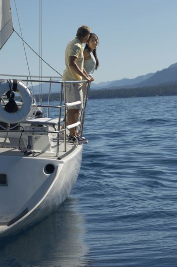 Full length of a couple travelling in a sailboat