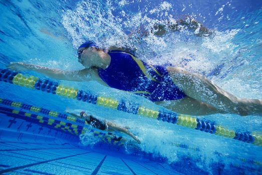 Underwater view female swimmers racing