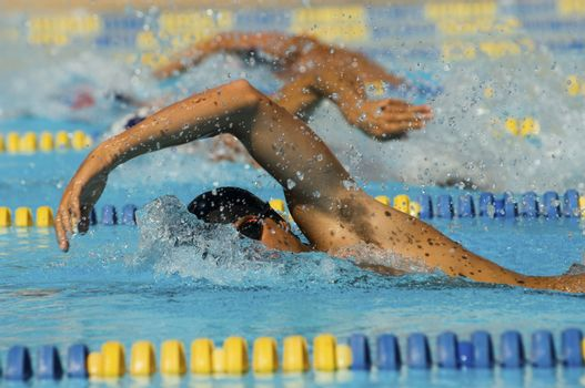 Male participants competing in a swimming race