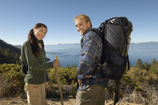 Portrait of happy young hiking couple on coastal track