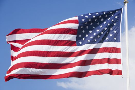 American flag with sky in the background