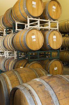 Wooden wine barrels in winery cellar