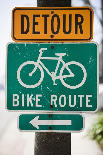 Bike route sign with arrow showing the direction