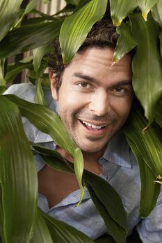 Portrait of a happy mature man at botanical garden