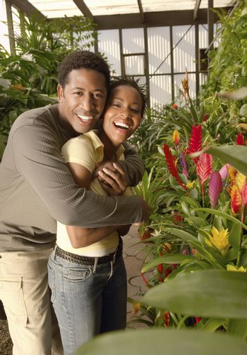 Portrait of an African American couple hugging at botanical garden