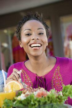Happy Woman Having Salad At Cafe