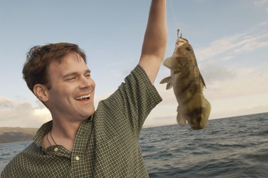 Cheerful mature man with his catch