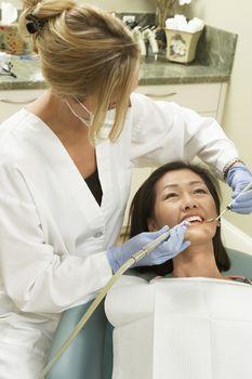 Woman At Clinic For Dental Checkup