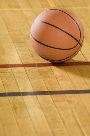 Close-up of a basketball on wooden floor