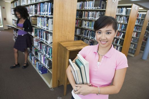 Asian Female Holding Books