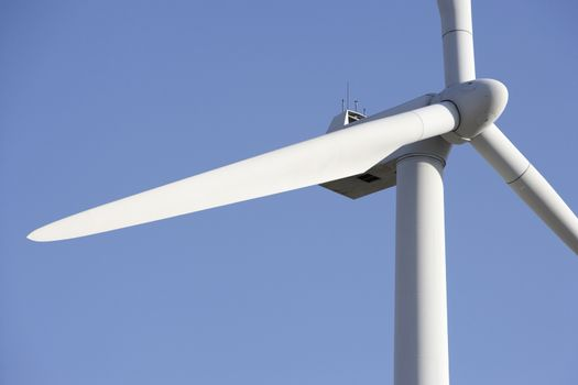 Close-up of a wind turbine against clear sky