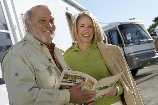 Senior Couple Holding A Brochure