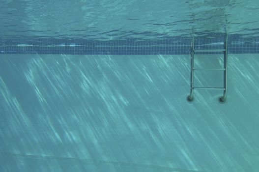 Underwater of a swimming pool ladder