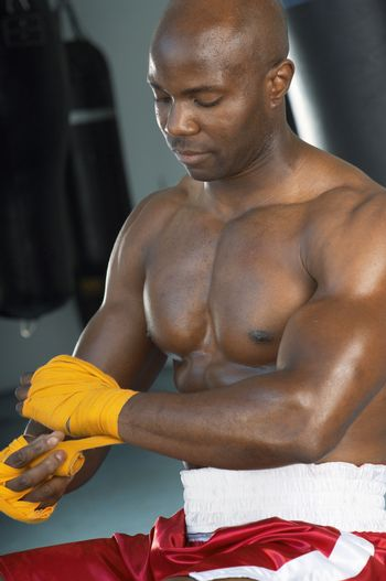 Mature boxer preparing himself for a boxing match