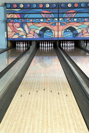 Lane of a bowling alley game with tenpins