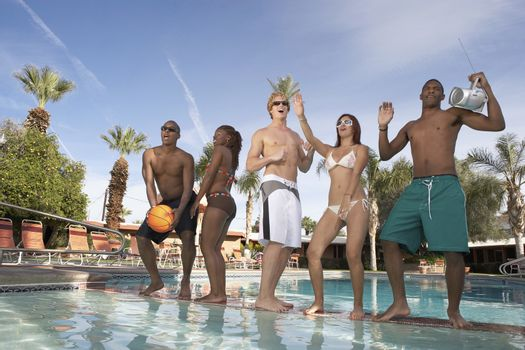 Young People Dancing at a Pool Party